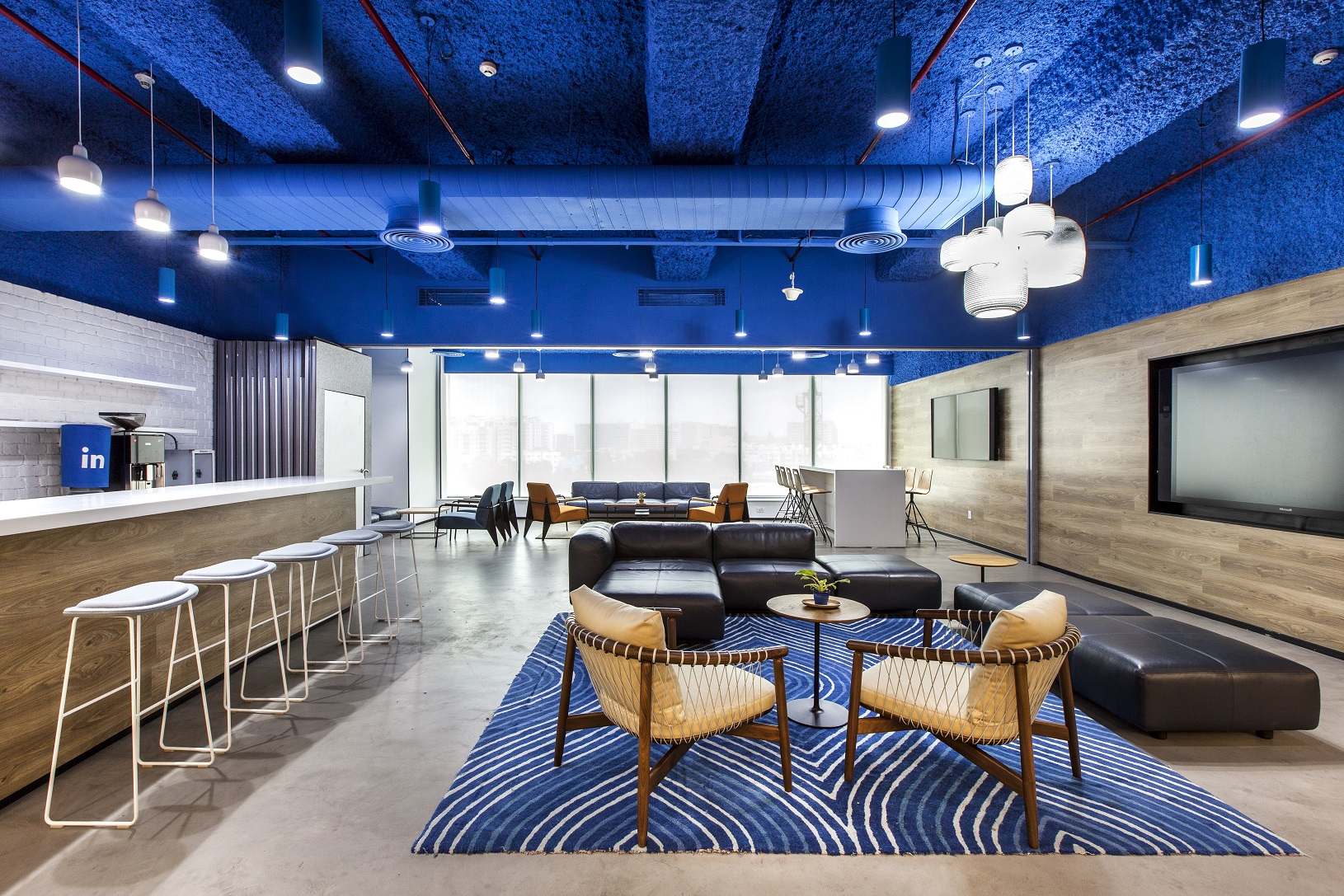 Classic Blue is used liberally in Space Matrix's office design concept for LinkedIn Bangalore.