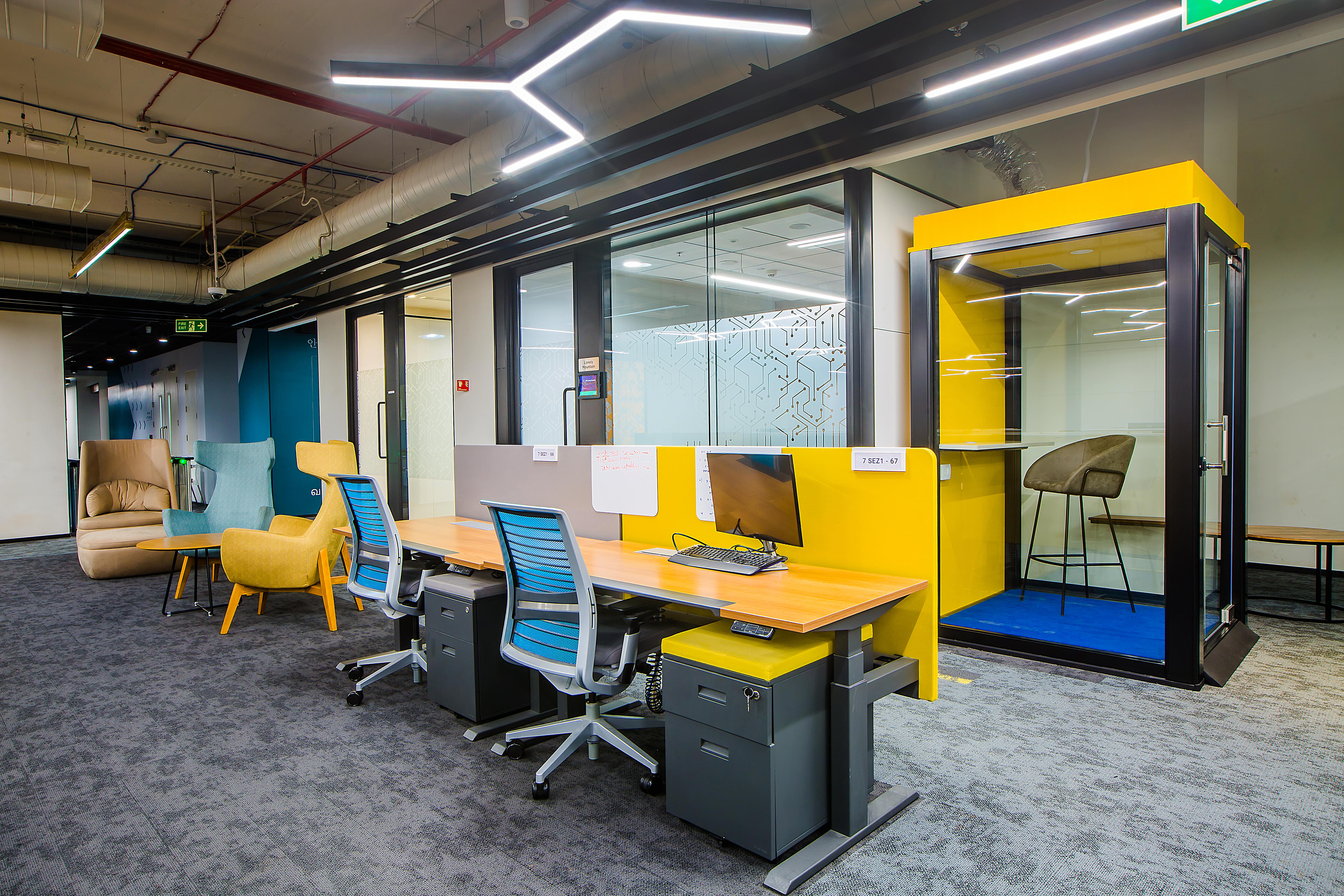 Ergonomic chairs and workstations and flexible seating options make the Rubric India office one of the best workplace designs